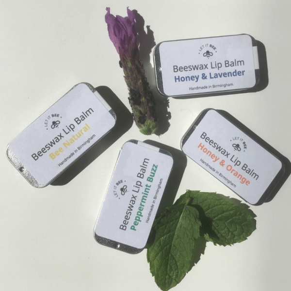 4 tins of Beeswax Lip Balm with piece of Lavender and some mint leaves