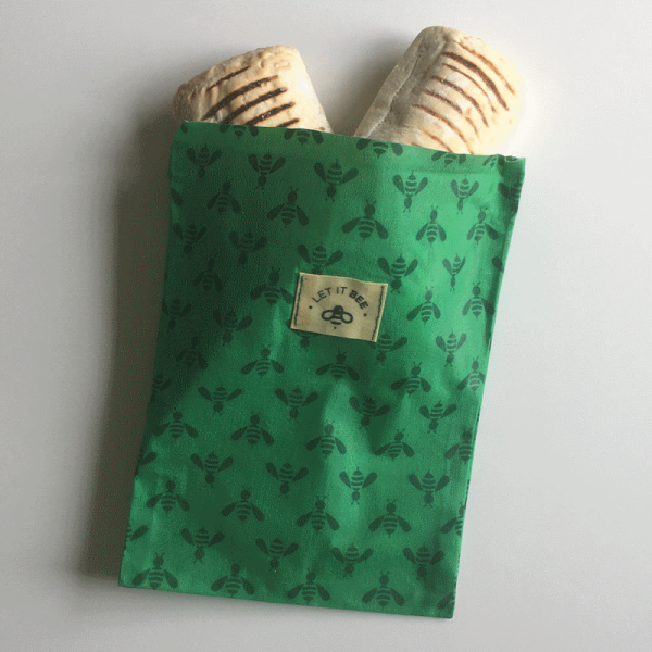 Beeswax Snack Bag with 2 paninis sticking out of the top